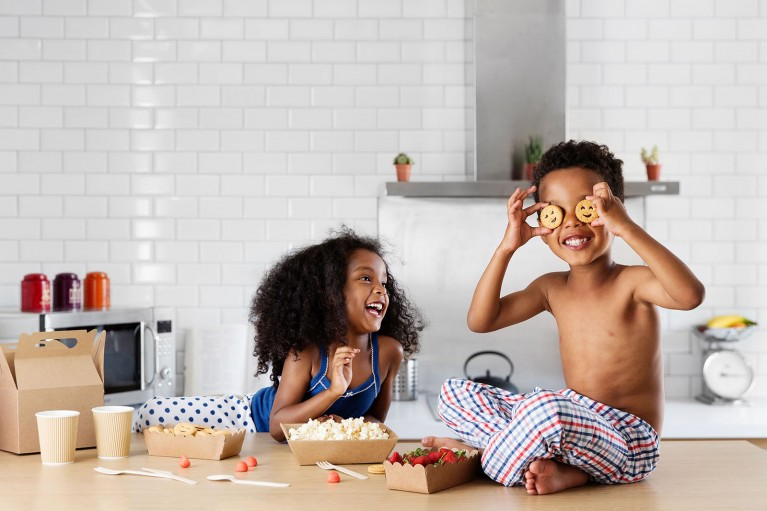 pic of two kids being silly with food by Lisa Tichane