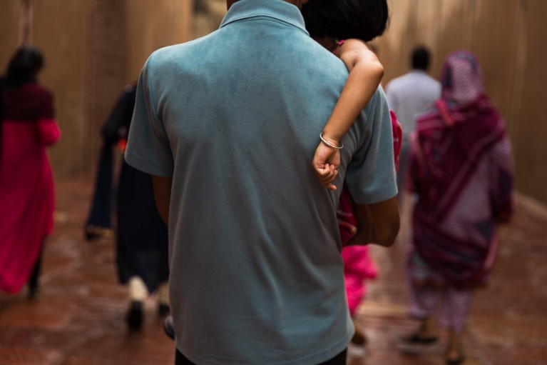 picture of dad carrying daughter by anda panciuk