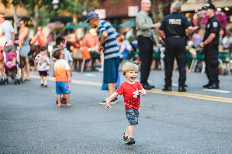 picture of kid in a red shirt running down the street by Francesca Russell