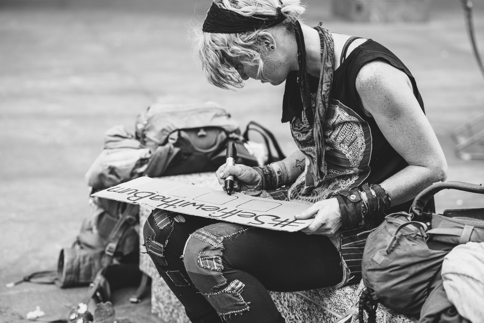picture of woman writing on cardboard by Francesca Russell