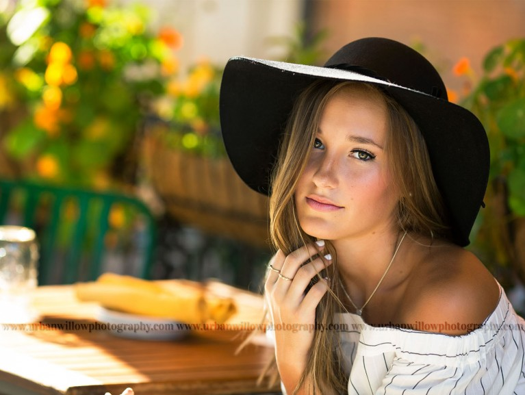 senior photography of girl with a hat on by Lori Vieth