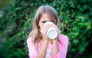 picture of girl drinking a hot drink outside by Erica Everhart