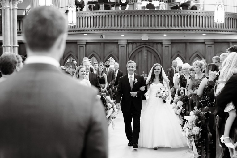 black and white photo of dad walking daughter down the aisle by Vanessa Joy