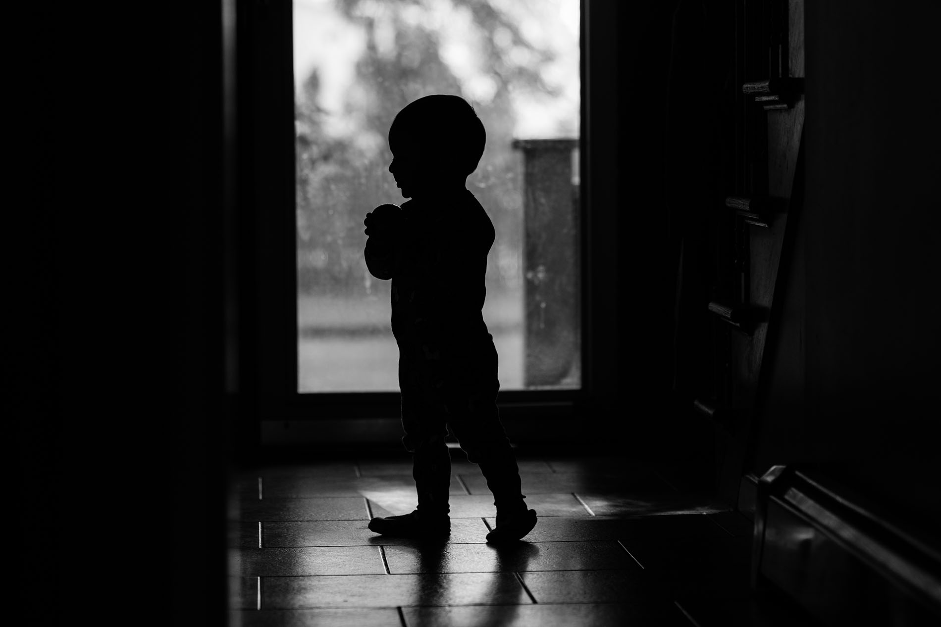 black and white silhouette of boy by Jessica Svoboda