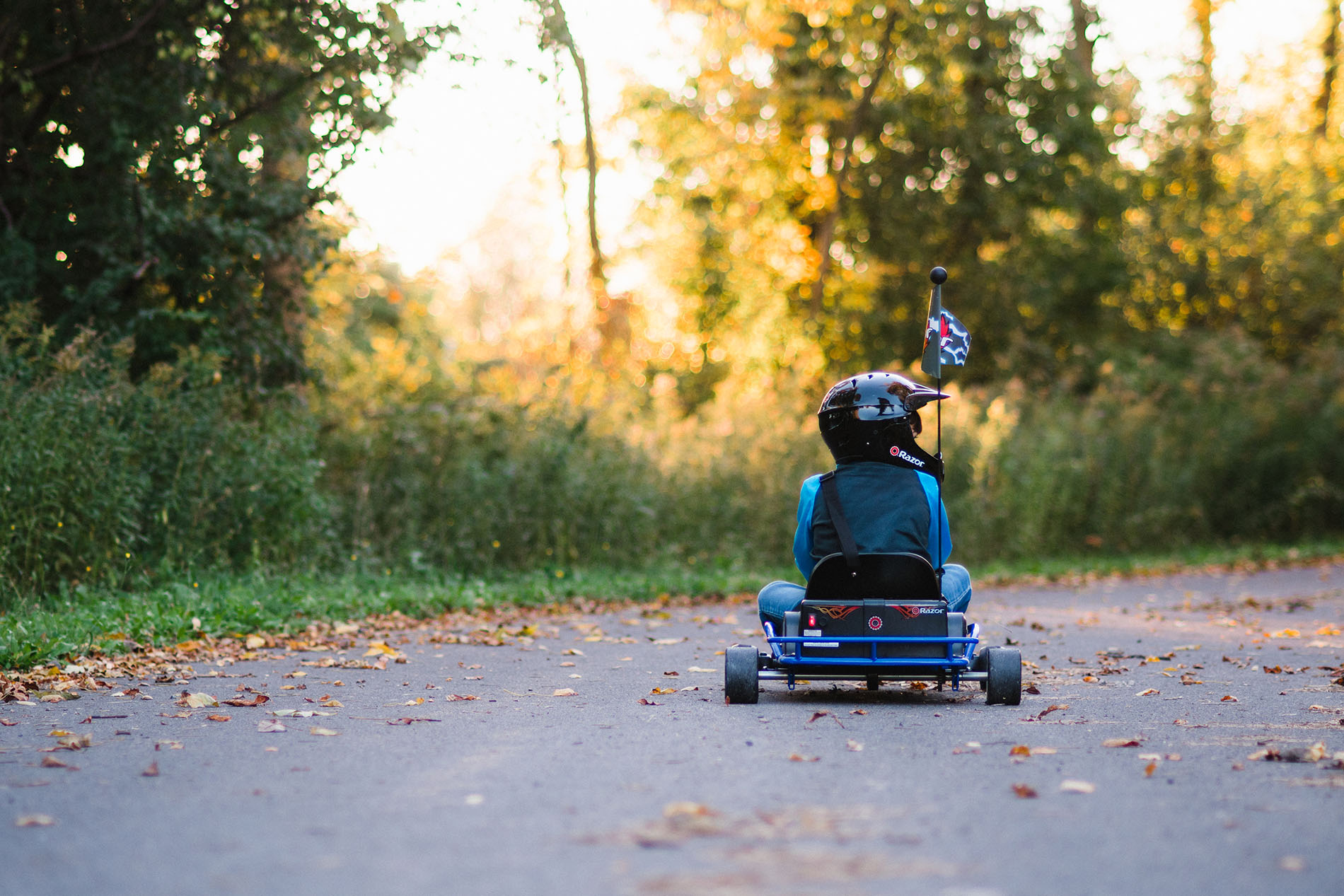 boy riding a gocart by Jessica Svoboda