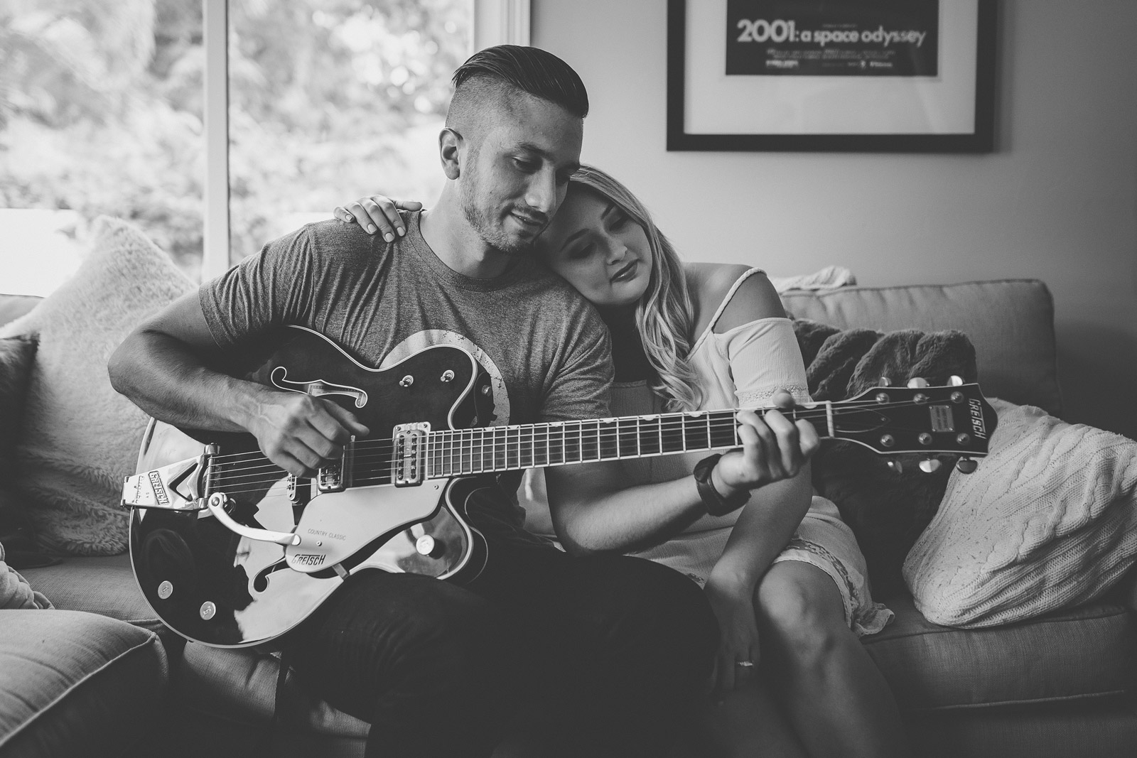 husband showing wife how to play the guitar by Tami Keehn