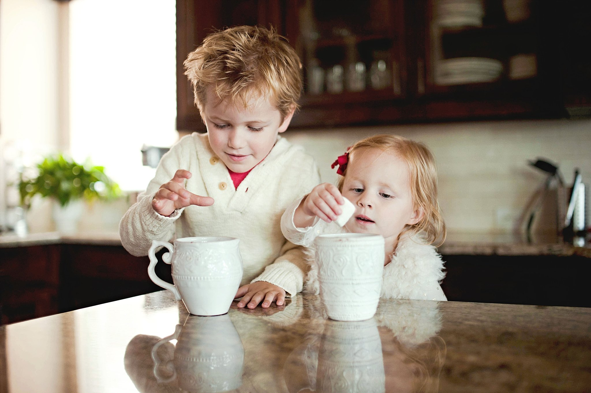 kids having marshmallows and hot chocolate by Erica Williams