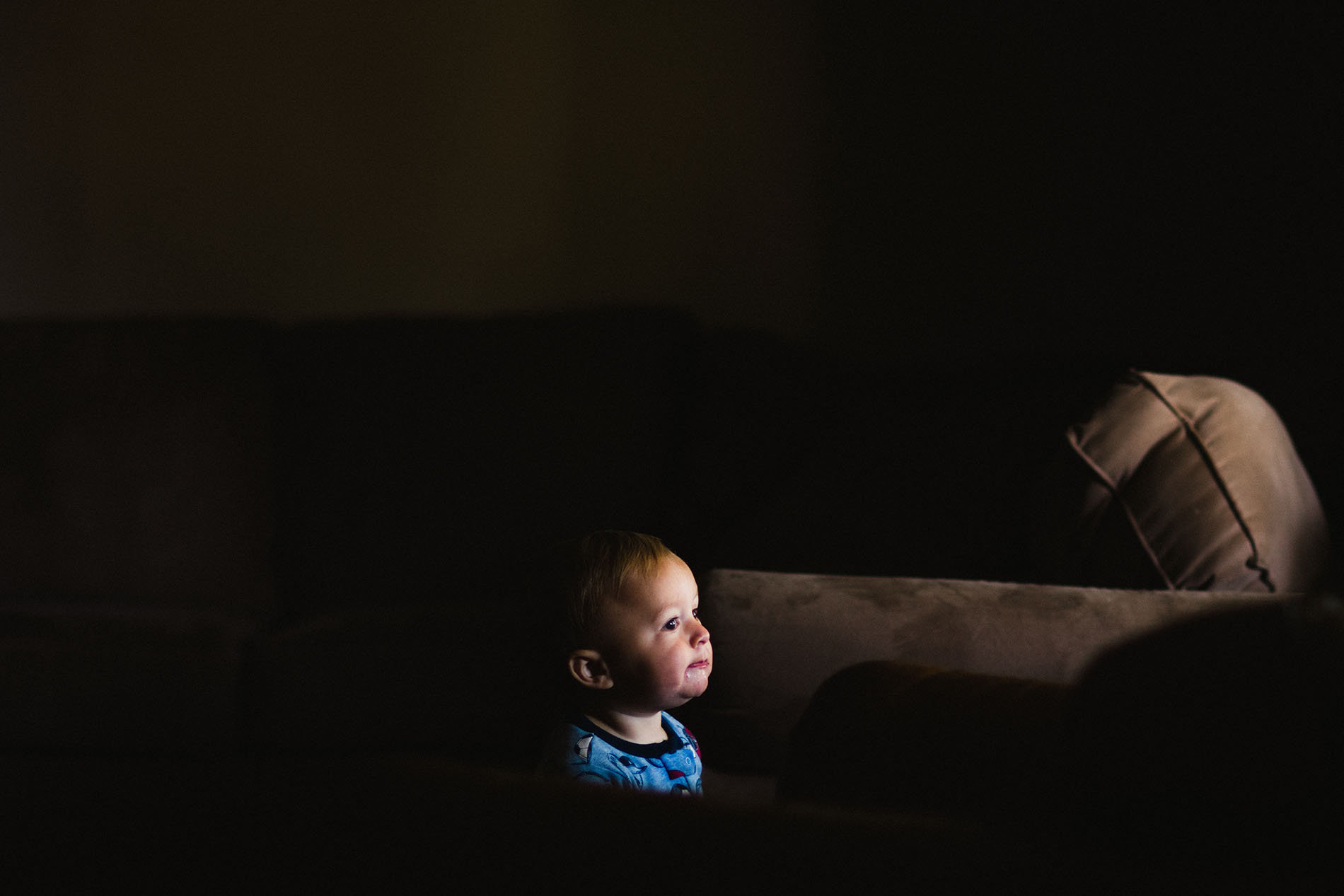 low light photo of boy by Jessica Svoboda