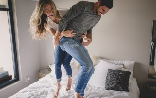 photo of couple jumping on the bed by Tami Keehn
