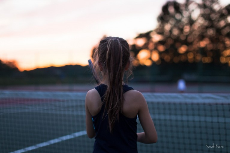 photo of girl playing tennis by Sarah Keene