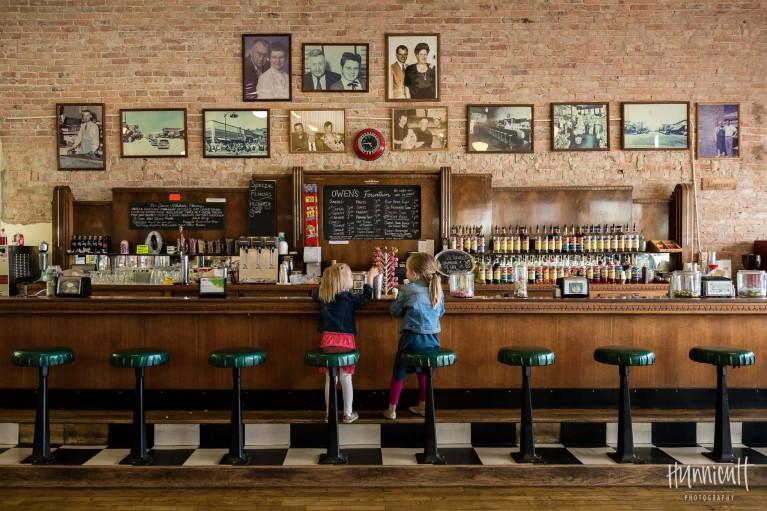 photo of girls sitting in a soda fountain shop by Rebecca Hunnicutt Farren