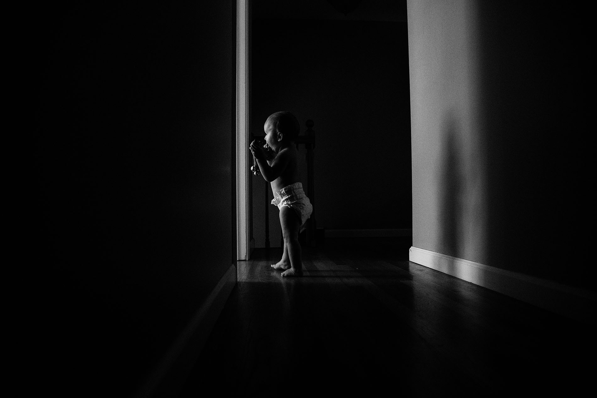 photo of kid walking down hallway by Jessica Svoboda