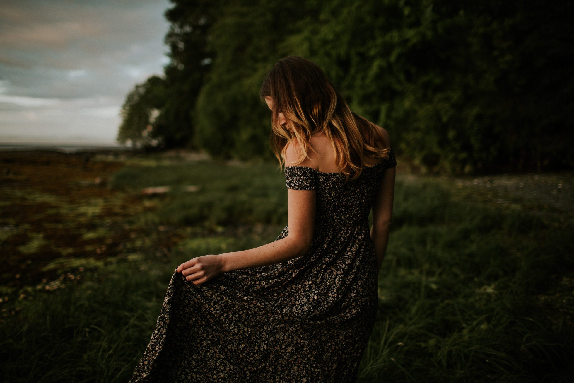 photo of woman in a field by Cassandra Casley