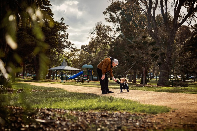 picture of grandpa and toddler walking in the park by Annick Paradis