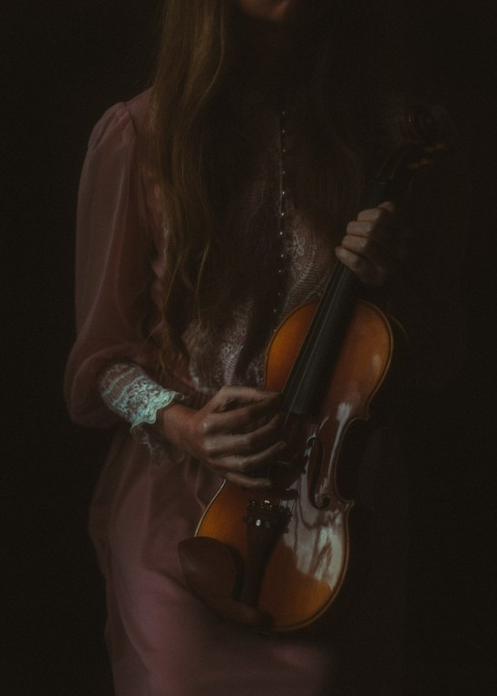 self portrait of woman playing music by Sharon Covert