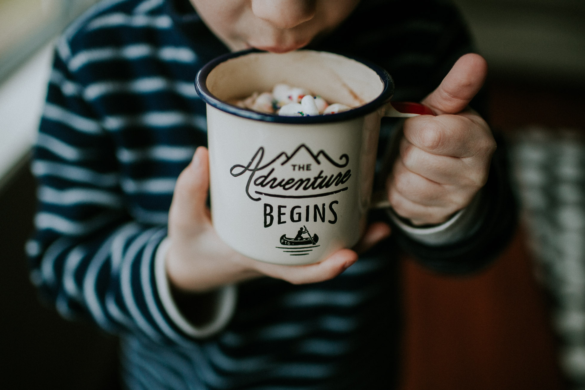 the adventure begins mug with hot chocolate in it by Cassandra Casley