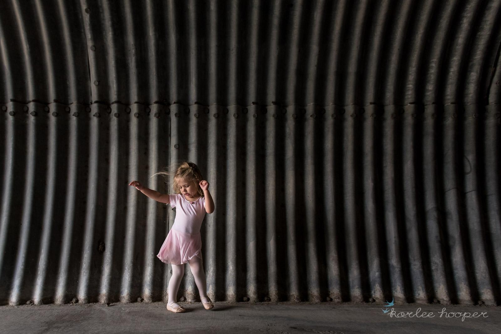 minimalist photo of a girl ballerina dancing by Karlee Hooper