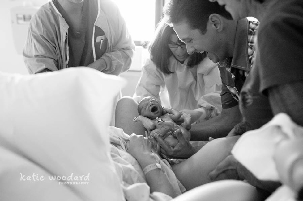black and white picture of baby being born by Katie Woodard