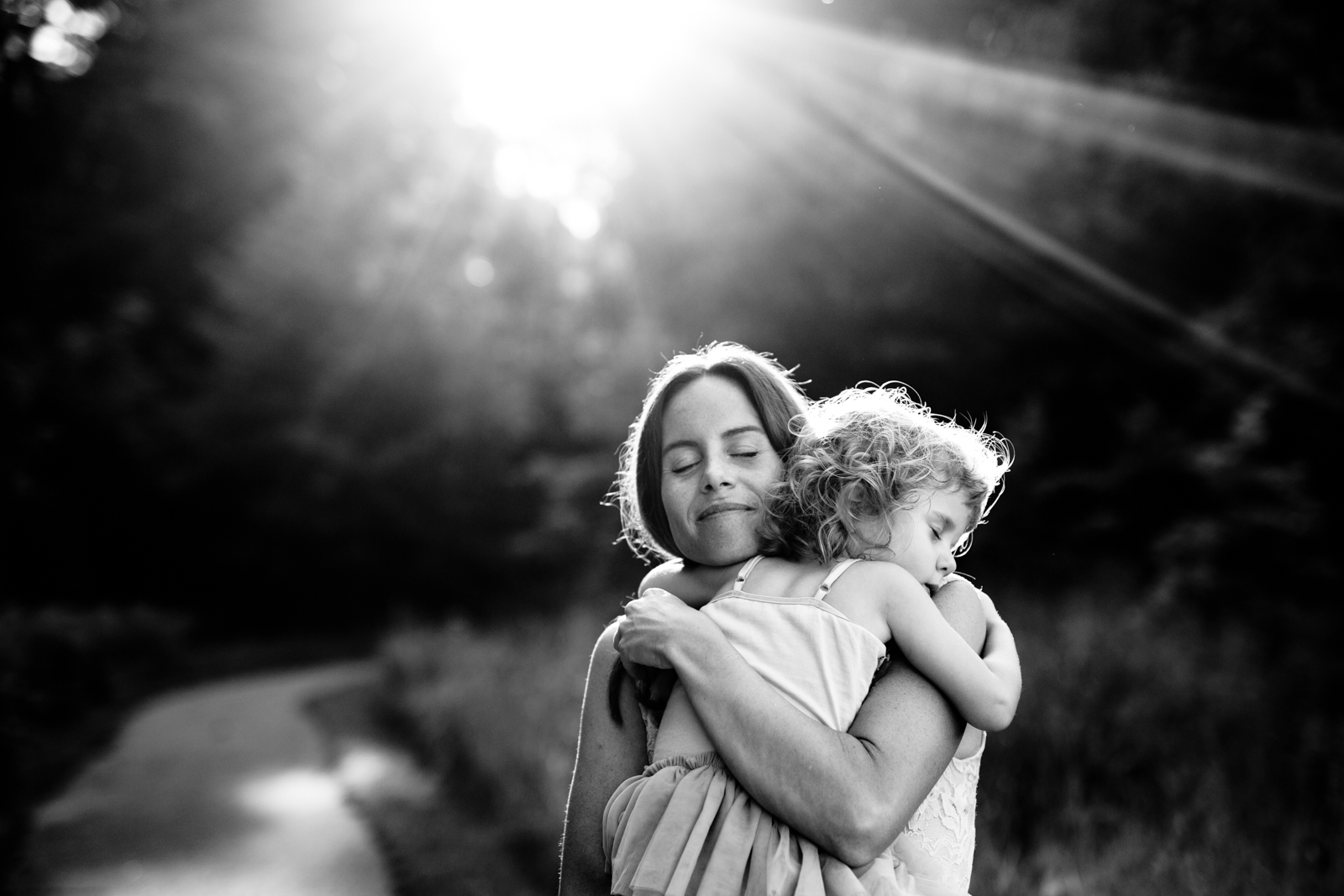 backlit photo of mom and daughter hugging by Sarah Rypma
