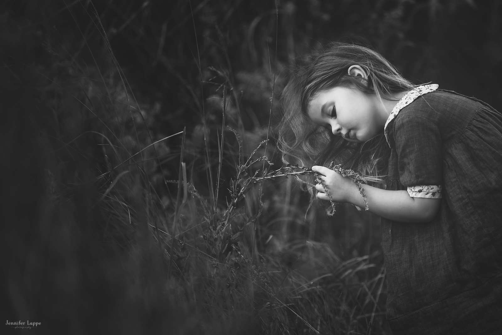 black and white pic of girl in the grass by Jennifer Lappe