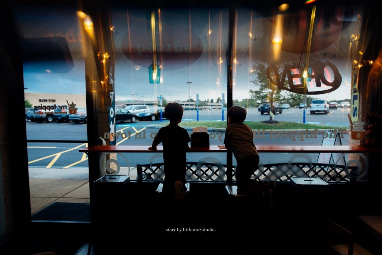 pic of boys sitting at a countertop in a Pittsburgh diner by Andrea Moffatt