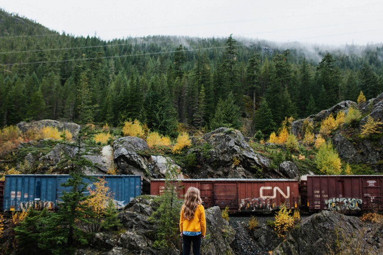fall photo of girl looking at train in Canada by Beth Crossman