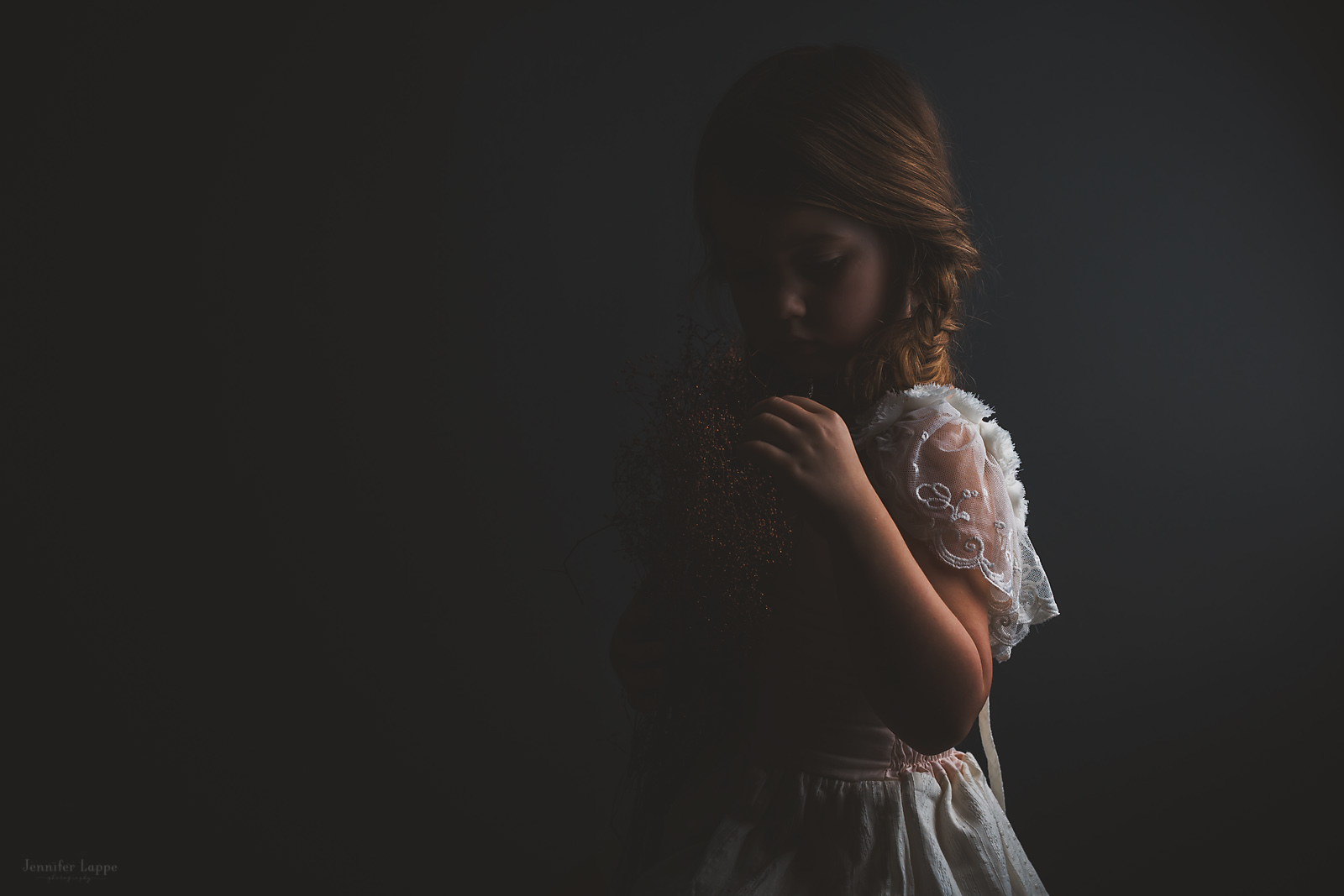 low light picture of girl in a white dress by Jennifer Lappe