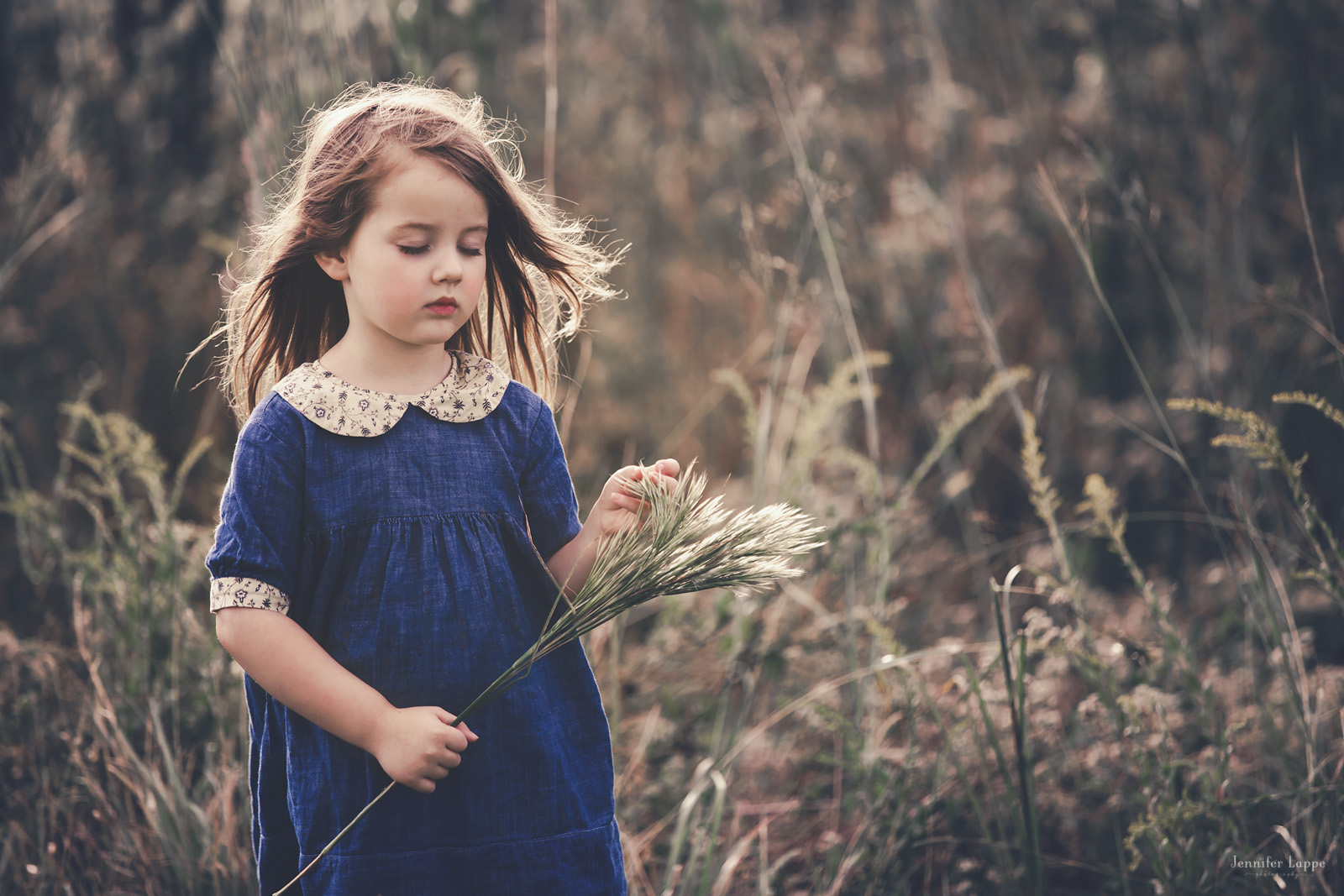 photo of girl carrying grass outside by Jennifer Lappe