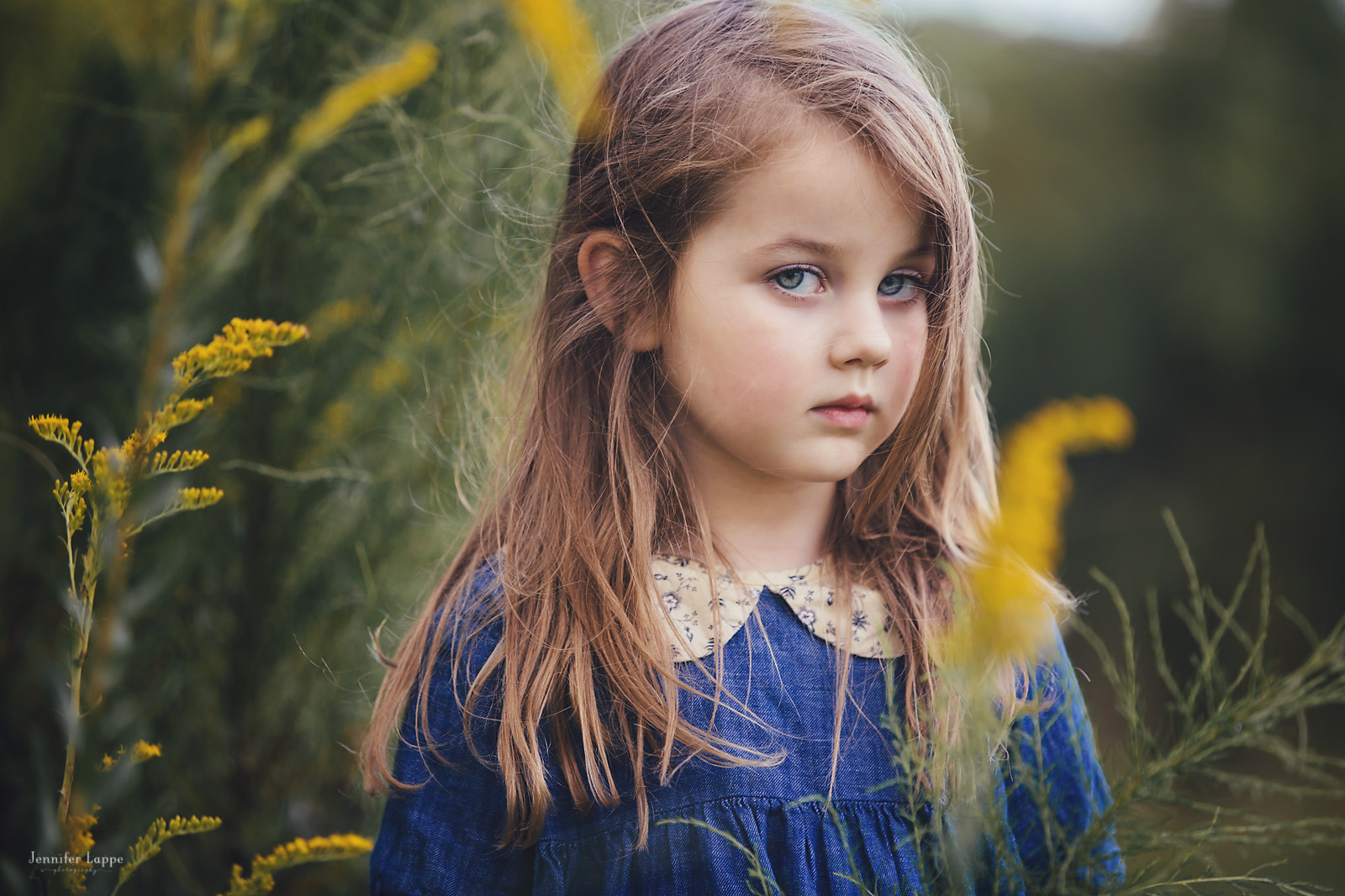 photo of girl outdoors by yellow flowers by Jennifer Lappe