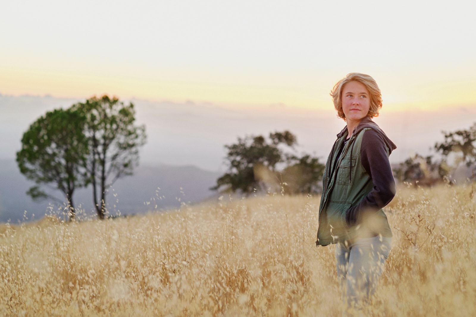 photo of girl standing in a field by Michelle Turner