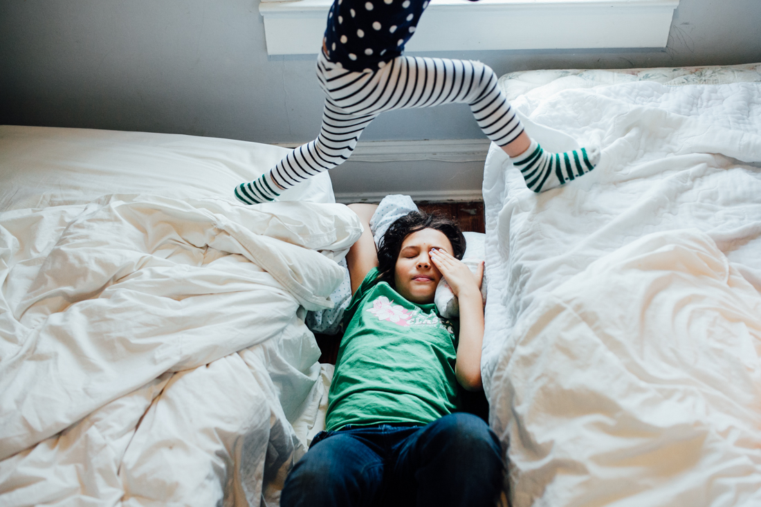 photo of kid jumping between beds by Juliette Fradin