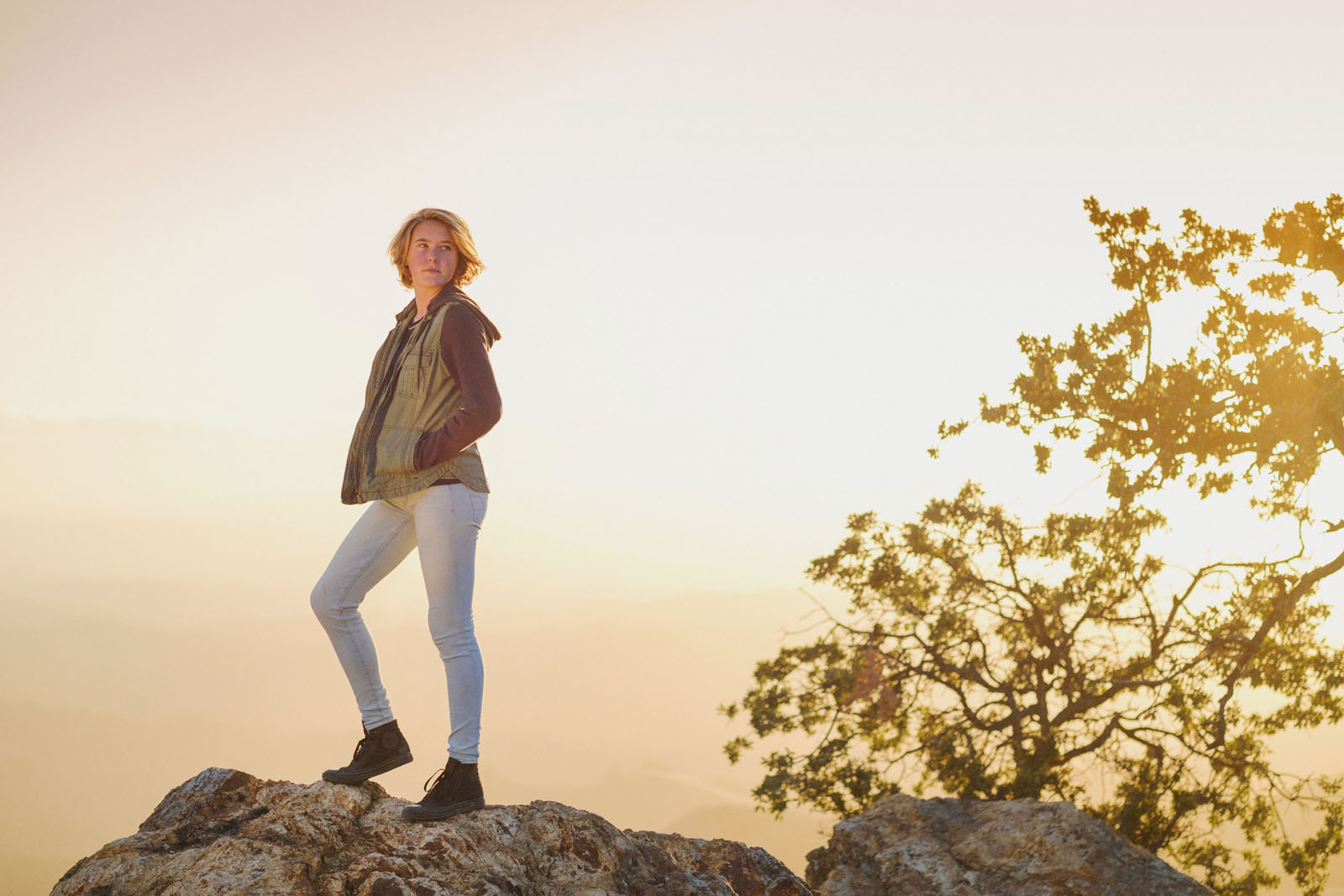 photo of teen standing on rocks by Michelle Turner