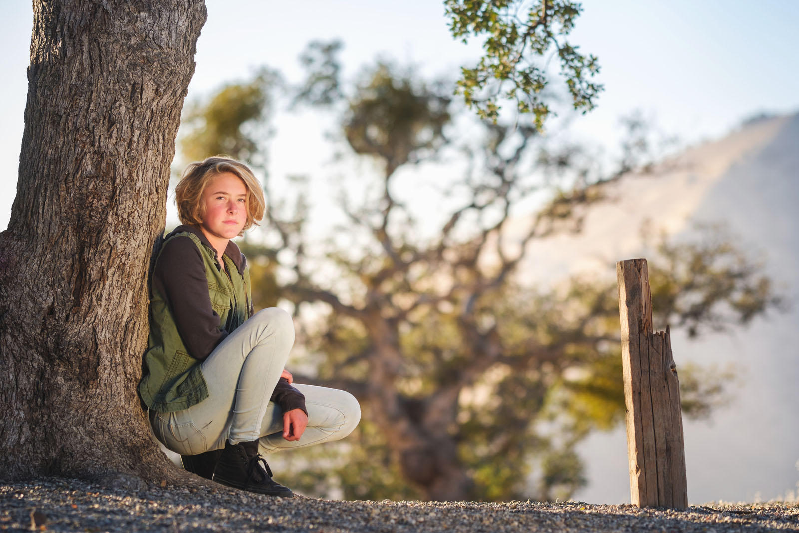 pic of teen girl sitting by a tree by Michelle Turner