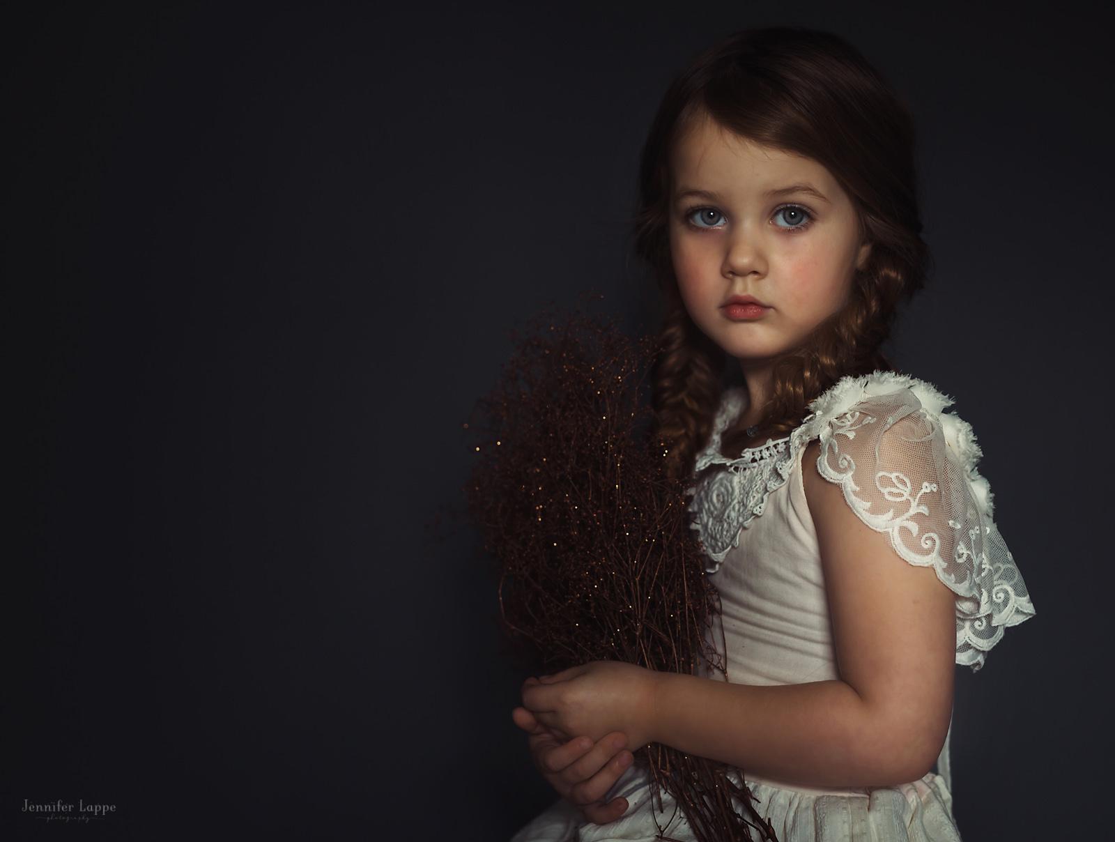 window light portrait of girl in a white dress by Jennifer Lappe