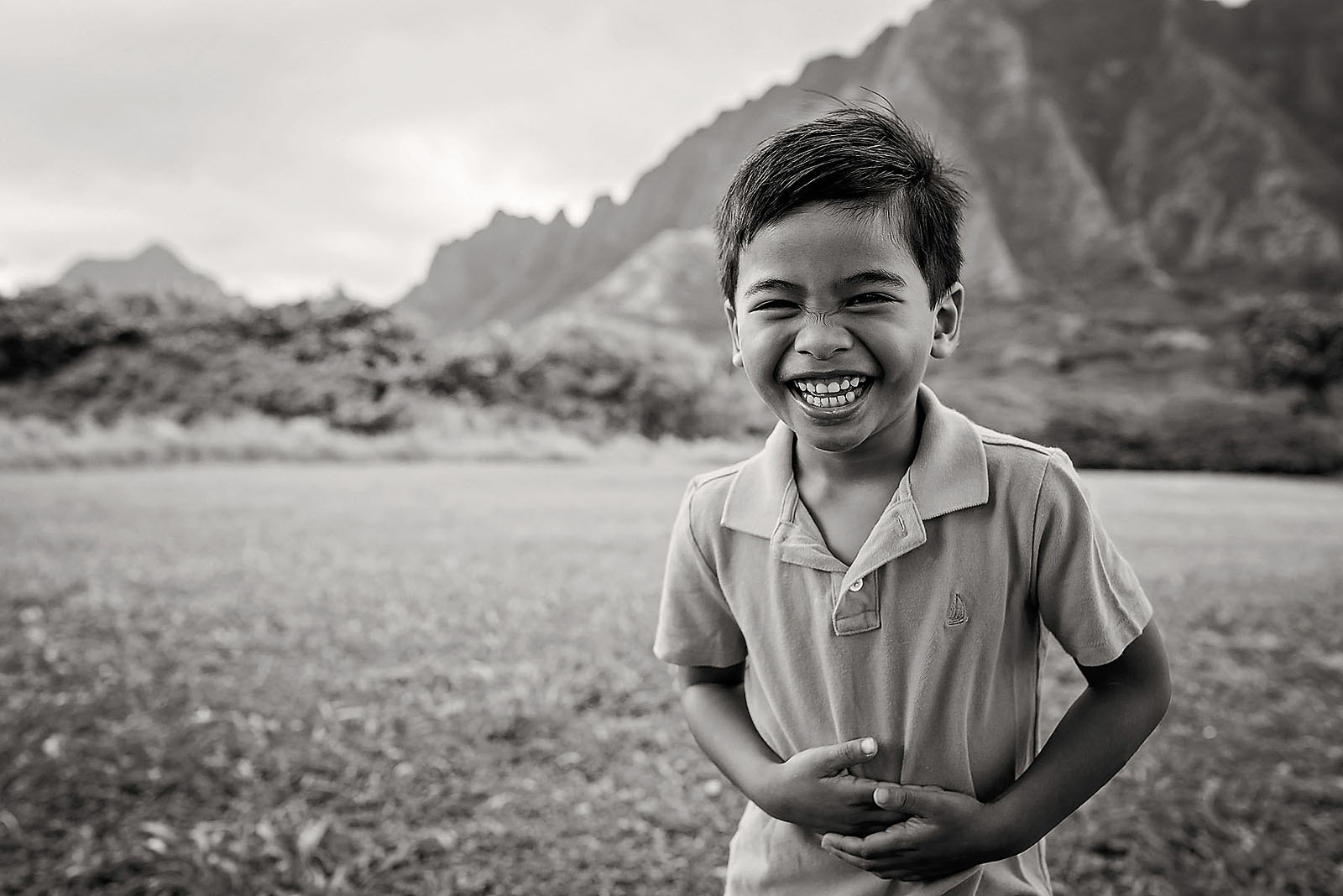 black and white photo of boy laughing by Allison Gipson