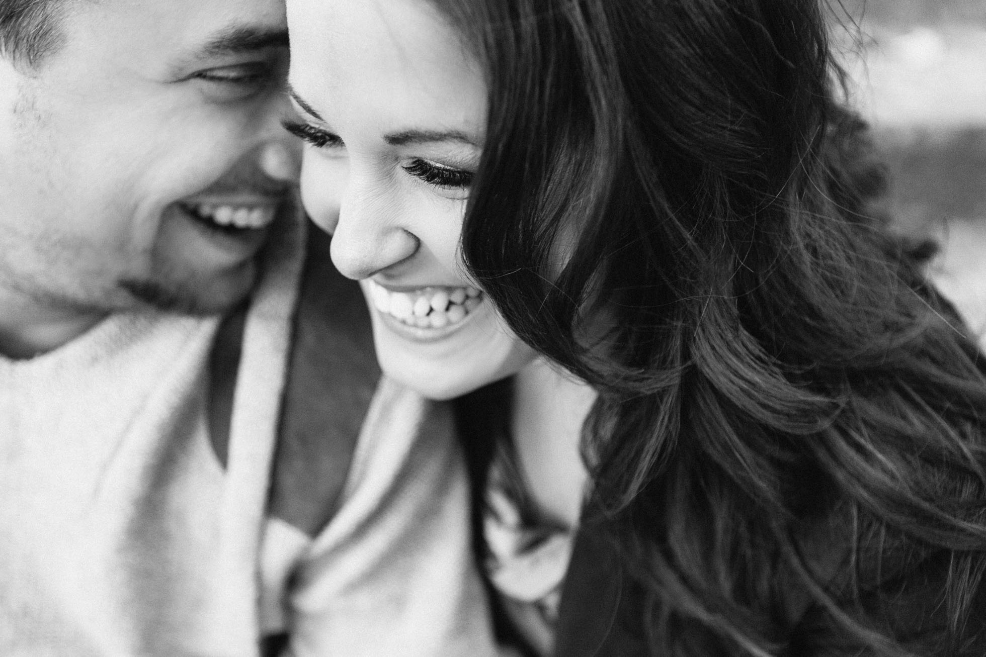 black and white photo of couple laughing by Sonia Bourdon