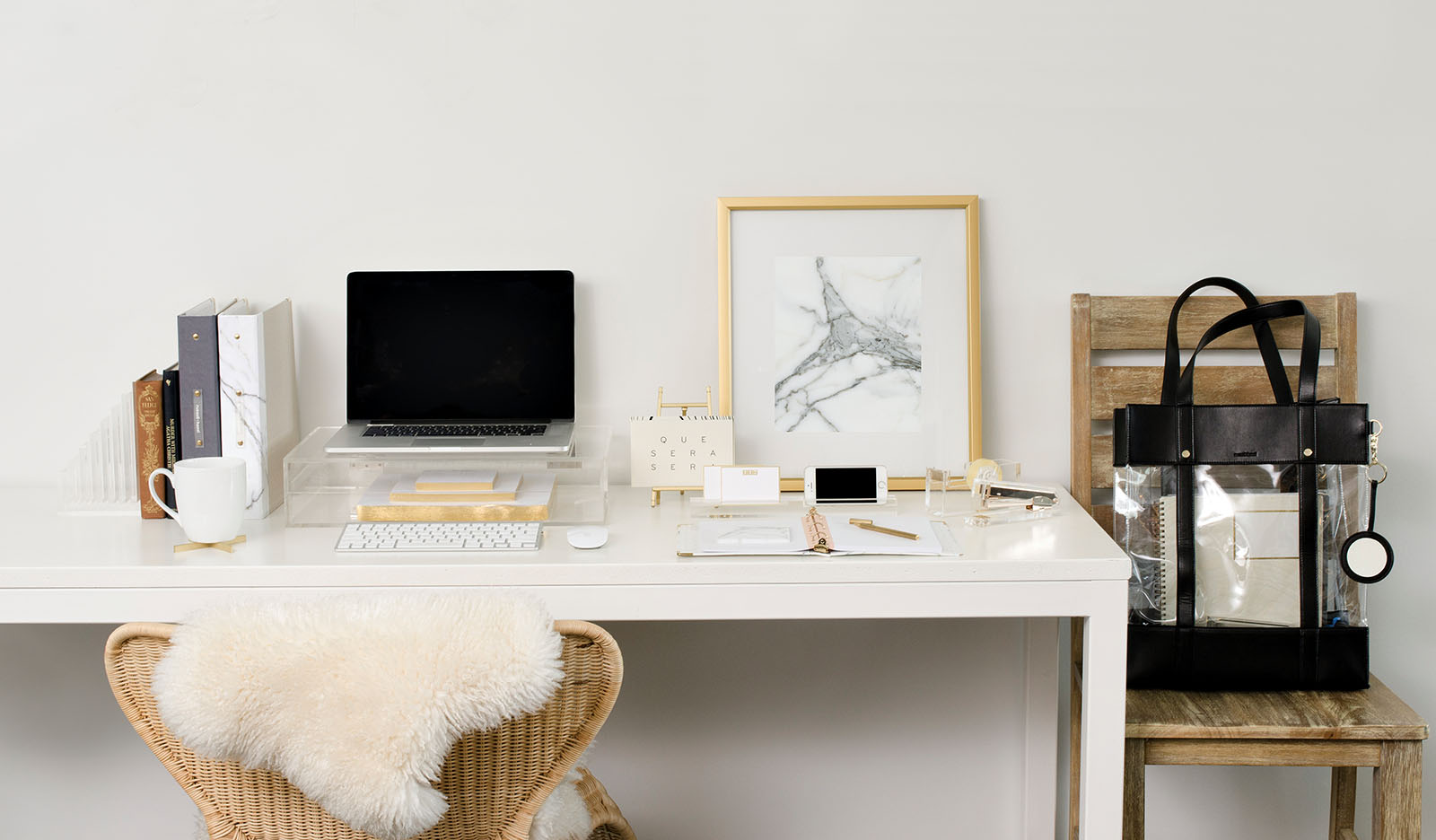 desk with gold and acrylic supplies