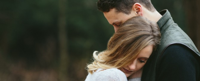 outdoor photo of couple hugging by Faye Sevel