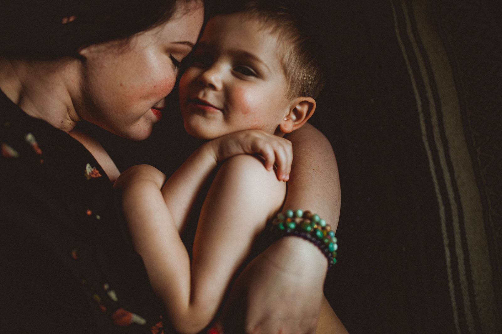photo of mom and son snuggling by Keziah Kelsey