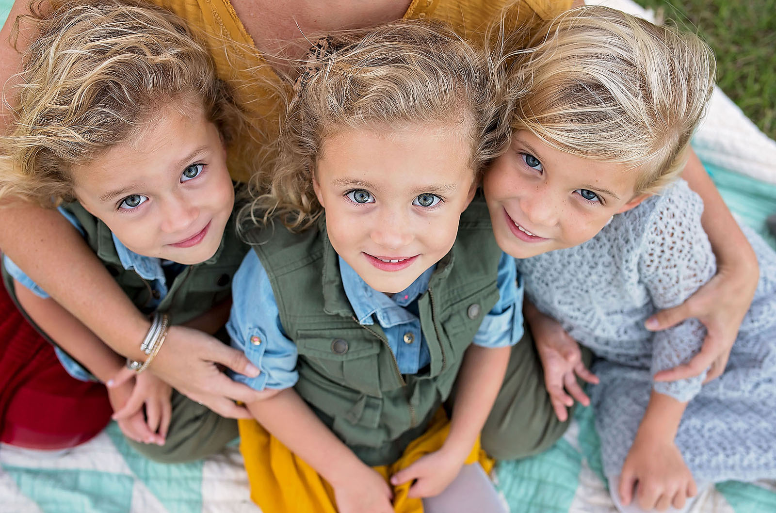 picture of 3 little girls looking up and smiling by Allison Gipson