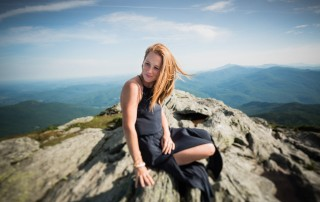 photo of woman sitting on top of a mountain by Sonia Bourdon