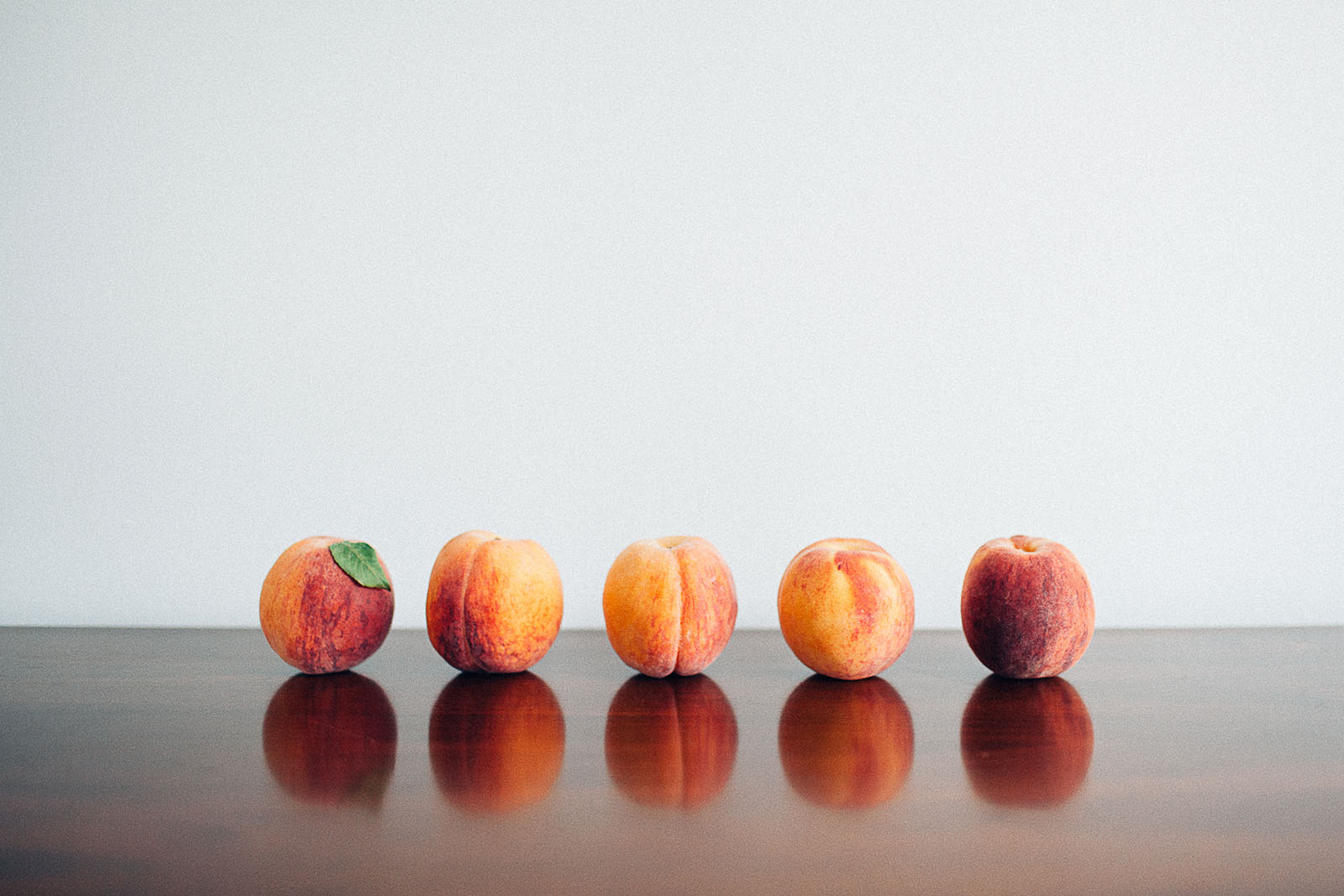 picture of a row of peaches by Sarah Lalone
