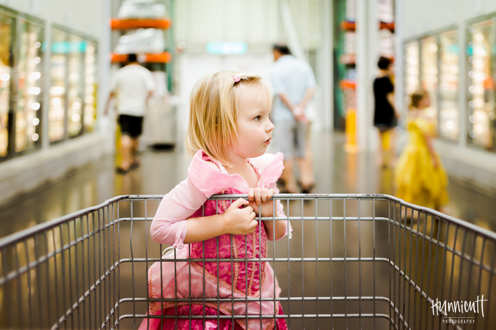 girl dressed as Sleeping Beauty at the grocery store by Rebecca Hunnicutt Farren