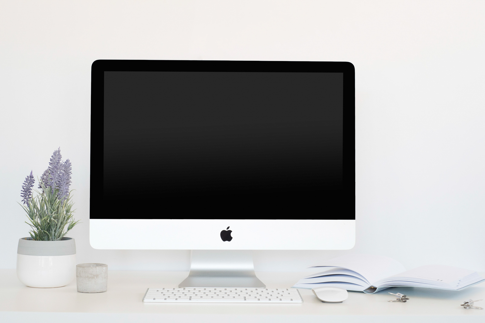 stock photo of iMac on white desk by Jana Bishop