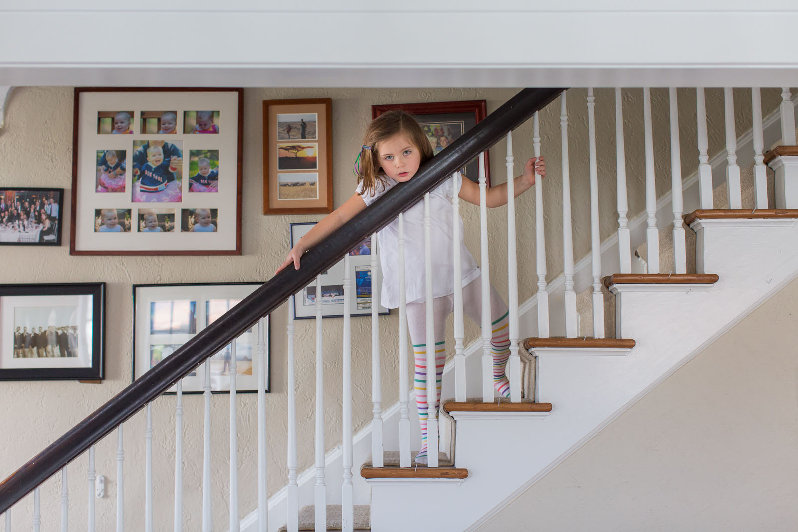 little girl playing on the stairs by Jaye McLaughlin
