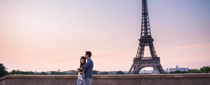 self portrait of couple embracing in front of the Eiffel Tower in Paris France by Alice Che