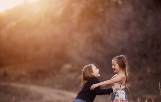photo of two girls laughing together by Sally Molhoek