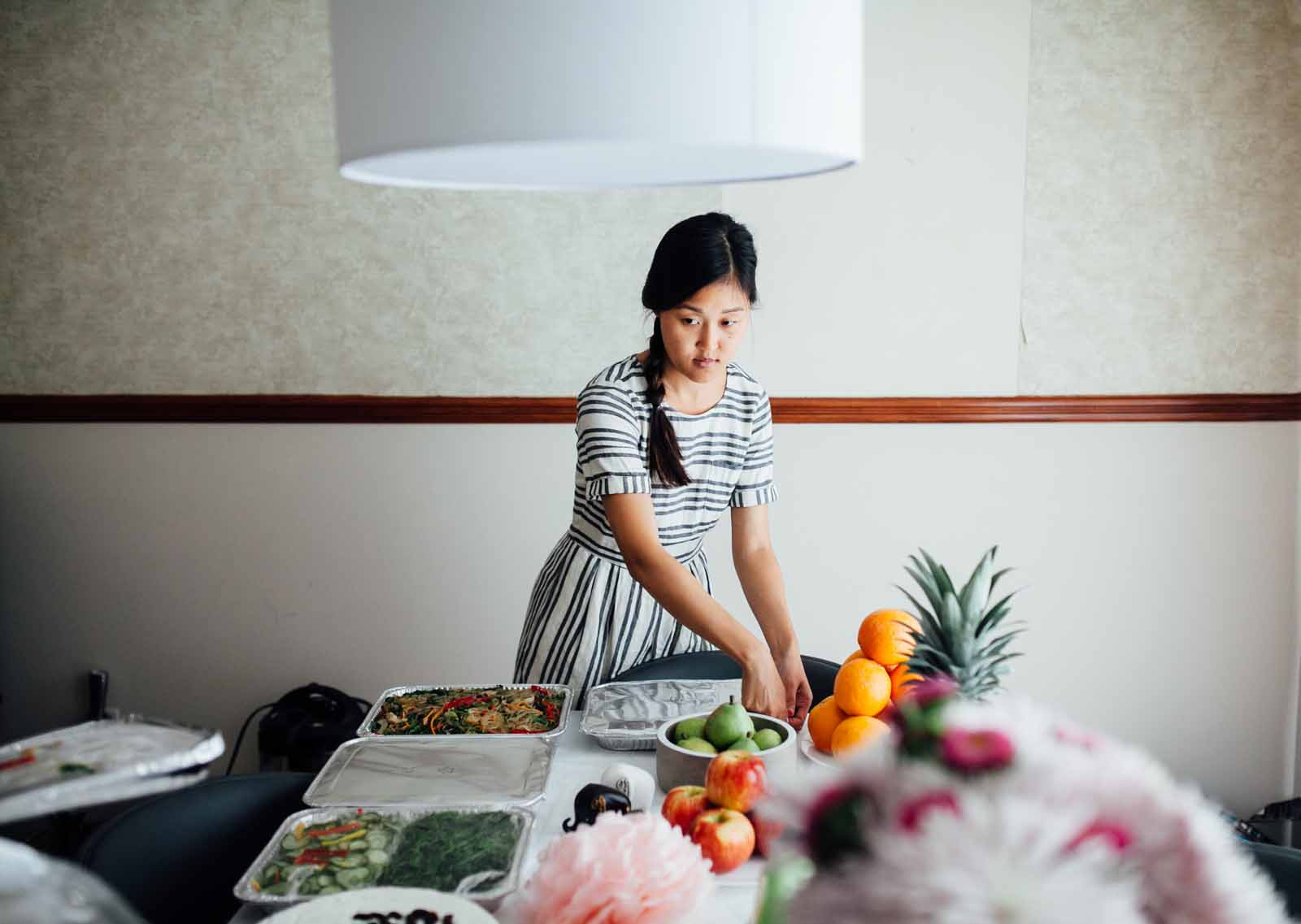 a Korean mom sets the table for a Baek-il event or 100th day celebration
