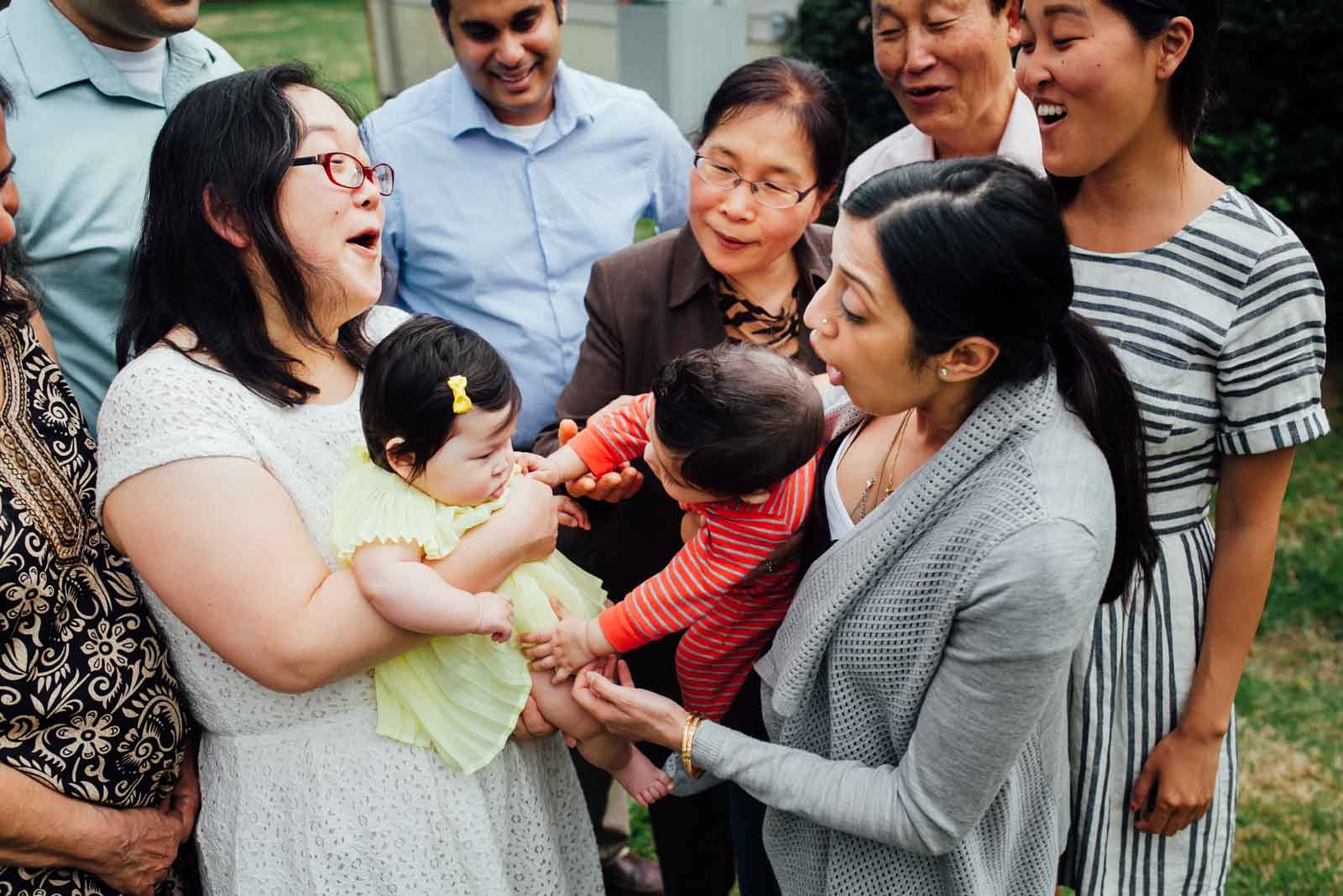 Even photography of A family interacts with new baby at Baek-il, a Korean 100 days celebration