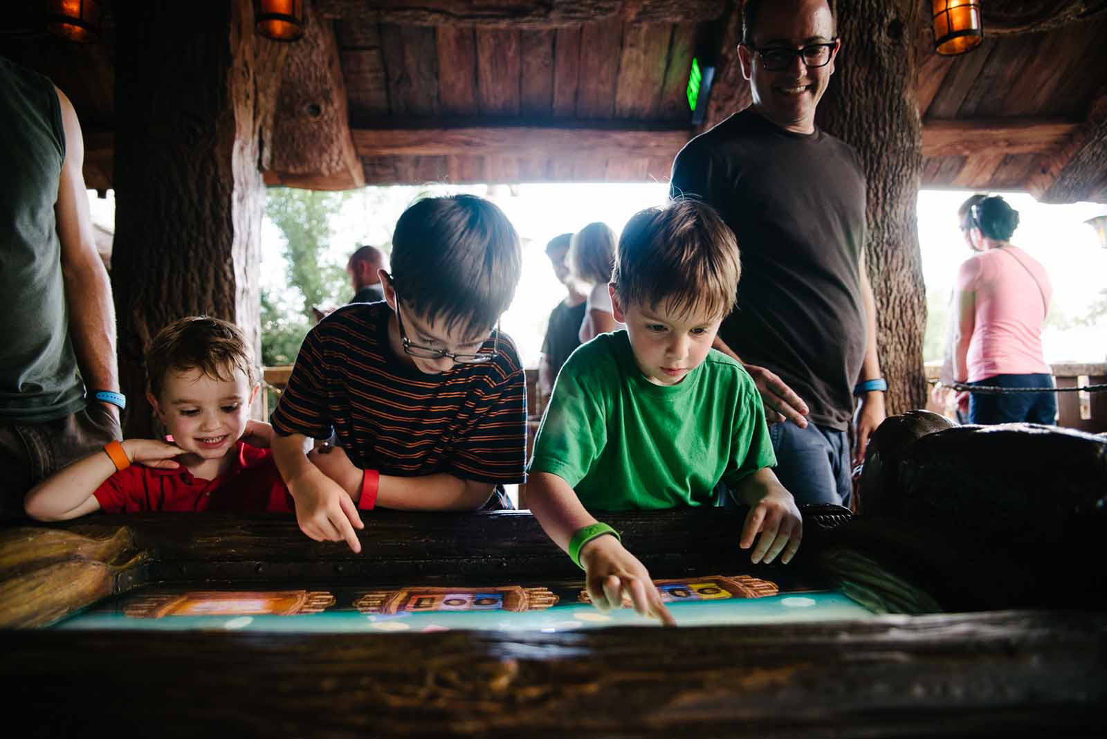 Disney photo of boys looking at a screen during down time